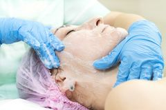 Process cosmetic mask of massage and facials. In beauty salon Stock Photo