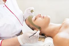 Process cosmetic mask of massage and facials. In beauty salon Stock Photography