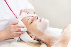 Process cosmetic mask of massage and facials. In beauty salon royalty free stock images