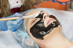 Process cosmetic mask of massage and facials. In beauty salon royalty free stock photo