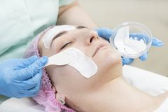 Process cosmetic mask of massage and facials. In beauty salon Stock Image