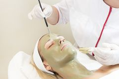 Process cosmetic mask of massage and facials. In beauty salon stock images