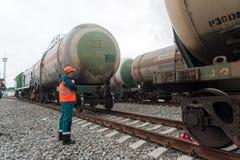 Process coupling locomotive with tank. Tobolsk, Russia - July 15. 2016: Sibur company. Denisovka railway station. Process coupling locomotive rolling stock with stock image