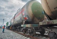 Process coupling locomotive with tank. Tobolsk, Russia - July 15. 2016: Sibur company. Denisovka railway station. Process coupling locomotive rolling stock with royalty free stock photo