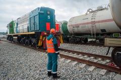 Process coupling locomotive with tank. Tobolsk, Russia - July 15. 2016: Sibur company. Process coupling locomotive rolling stock royalty free stock photos