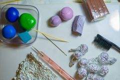 Polymer clay craft. Process of creating buds from polymer clay. Flat lay royalty free stock photos