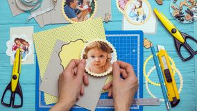Process of creating a childrens album. Scrapbook background. the process of creating a childrens album. Card and tools with decoration stock image