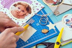 Process of creating a childrens album. Scrapbook background. the process of creating a childrens album. Card and tools with decoration stock photography