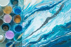 The process of creating a picture in the technique of fluid art liquid acrylic. The process of creating a picture of abstraction in the technique of fluid art stock images