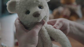 Process of creating a soft handmade toy. Work details: craft toy. In the old-fashioned style. Teddy bear as in the 20th century - fashionable collectible toys stock video footage