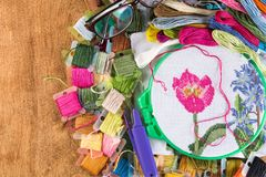 The process of cross-stitch. Canvas on hoops, needles, embroidery floss and pattern. Copy paste Royalty Free Stock Photography