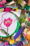 The process of cross-stitch. Canvas on hoops, needles, embroidery floss and pattern. Copy paste Royalty Free Stock Photo