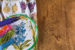 The process of cross-stitch. Canvas on hoops, needles, embroidery floss and pattern. Copy paste Royalty Free Stock Images