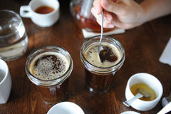 The process of cupping. Tasting freshly brewed coffee with spoons. Coffee accessories on the table Royalty Free Stock Image