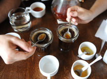 The process of cupping. Tasting freshly brewed coffee with spoons. Coffee accessories on the table Stock Photo