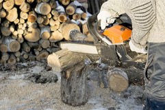 The process of cutting firewood with chainsaw Stock Photography