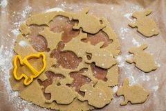 Process of cutting gingerbread cookies in the form of a rabbit royalty free stock photos