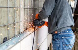 The process of cutting metal angles using angle grinder Royalty Free Stock Image