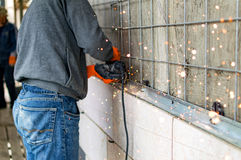 The process of cutting metal angles using angle grinder Stock Image