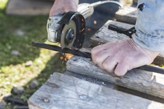 The process of cutting metal using the angle grinder.  Royalty Free Stock Images