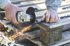 The process of cutting metal using the angle grinder.  Stock Images