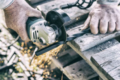The process of cutting metal using the angle grinder. Effect. The process of cutting metal using the angle grinder. Ukraine Royalty Free Stock Photography