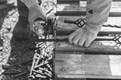 The process of cutting metal using the angle grinder. Grayscale effect. The process of cutting metal using the angle grinder. Ukraine Royalty Free Stock Image