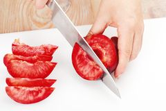 The process of cutting plums Stock Image