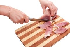 Process of cutting of pork Royalty Free Stock Image