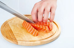 The process of cutting salmon Royalty Free Stock Photo