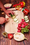 The process of cutting vegetables on a cutting board. Royalty Free Stock Photography