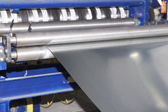 Process of cutting a wide sheet of metal into narrow strips on a machine. Russia stock images