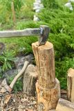 The process of cutting wood with a cleaver. Axe in the log. The process of cutting wood with a cleaver, axe, firewood, nature, timber, tree, work, forest, log royalty free stock image