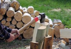 The process of cutting wood with a cleaver Royalty Free Stock Photography
