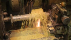Process deep hole drilling on a lathe using a generous flow of coolant, rotating portion. stock video