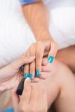 Nailcare. Process of doing manicure close-up Stock Photos