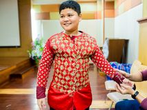 The process of dressing the Thai pantomime for the actors with hand sewing, repairing royalty free stock photography