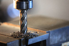 Process drilling steel plate by milling machine Royalty Free Stock Image