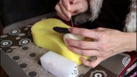 The process of dry felting. Wool for felting, sponge, needle felting. Hand, brush women`s stock video
