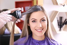 Process of dyeing hair at salon. Process of dyeing hair at beauty salon stock photo