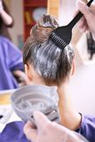 Process of dyeing hair at salon. Process of dyeing hair at beauty salon stock images