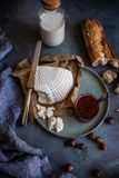 Cheese and jam. Appetizer plate on dark background. View from the top. royalty free stock photography