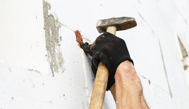 The process of fixing the dowel-umbrella with a hammer Stock Photography