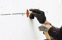 The process of fixing the dowel-umbrella with a hammer Stock Photos