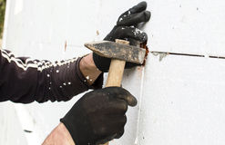 The process of fixing the dowel-umbrella with a hammer Royalty Free Stock Photos