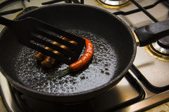Process of frying sausages 1 Stock Image