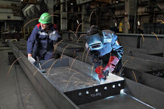 Process gas welding at plant for production of bridge structures. St. Petersburg, Russia - May 18, 2015: Steel sections of bridge span are manufactured  on plant Stock Photo