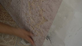 The process of gluing Wallpaper on the wall,the hand of the worker is smooth Wallpapers stock video