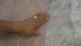 The process of gluing Wallpaper on the wall,the hand of the worker is smooth Wallpapers stock video footage
