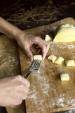 Process of gnocchi making. Shot of a person while making italian gnocchi with fork stock photos